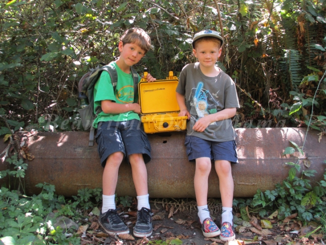 Brother and Young Son smiling with the cache box